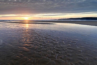 Sunset over the deserted sandy beach at Freshwater West, Pembrokeshire Coast National Park, Wales, United Kingdom, Europe