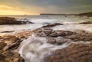 Waves surge over rock ledges on the North Cornish coast, Cornwall, England, United Kingdom, Europe