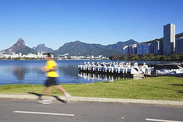 Person jogging on track around Lagoa Rodrigo de Freitas, Rio de Janeiro, Brazil, South America