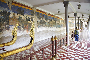 Woman looking at murals at Silver Pagoda in Royal Palace, Phnom Penh, Cambodia, Indochina, Southeast Asia, Asia