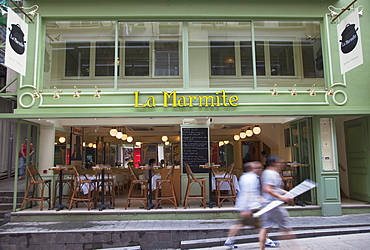 People walking past French bistro, Soho, Central, Hong Kong, China, Asia