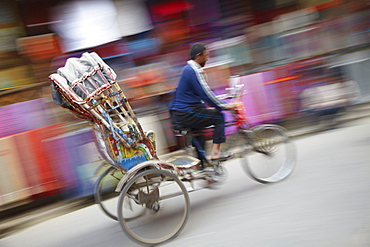 Man riding rickshaw, Kathmandu, Nepal, Asia