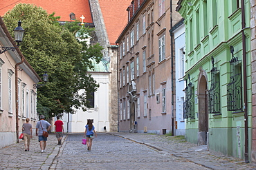 People walking along Kapitulska Street in Old Town, Bratislava, Slovakia, Europe