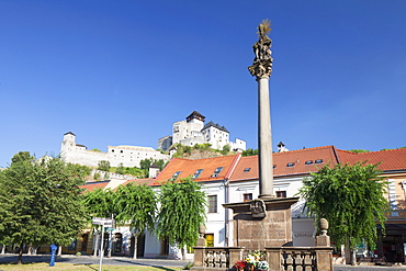 Monument in Mierove Square and Trencin Castle, Trencin, Trencin Region, Slovakia, Europe
