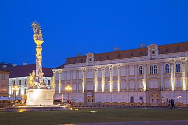 Baroque Palace and Trinity Column in Piata Unirii at dusk, Timisoara, Banat, Romania, Europe