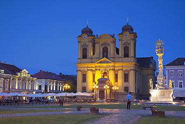 Roman Catholic Cathedral and Trinity Column in Piata Unirii at dusk, Timisoara, Banat, Romania, Europe