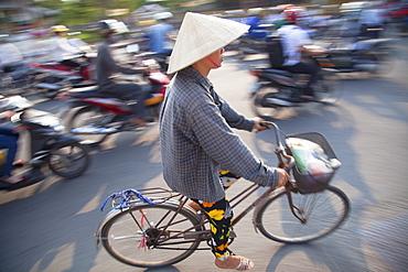 Woman riding bicycle, Hue, Thua Thien-Hue, Vietnam, Indochina, Southeast Asia, Asia