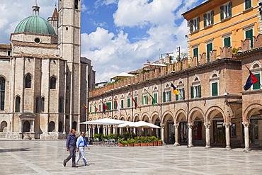 Men walking through Piazza del Popolo, Ascoli Piceno, Le Marche, Italy, Europe