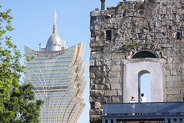 Ruins of Church of St. Paul with Grand Lisboa Casino in background, Macau, China, Asia