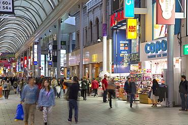 People walking along Hondori shopping arcade, Hiroshima, Hiroshima Prefecture, Japan, Asia