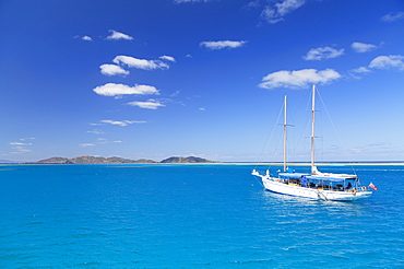 Yacht in lagoon with Malolo Island, Mamanuca Islands, Fiji, South Pacific, Pacific