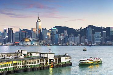 View of Star Ferry Terminal and Hong Kong Island skyline at dusk, Hong Kong, China, Asia