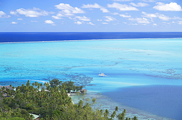 View of yacht in lagoon, Bora Bora, Society Islands, French Polynesia, South Pacific, Pacific