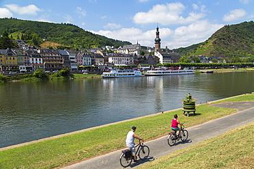 People cycling along River Moselle, Cochem, Rhineland-Palatinate, Germany, Europe