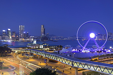 View of Star Ferry pier, observation wheel and Tsim Sha Tsui skyline, Central, Hong Kong, China, Asia