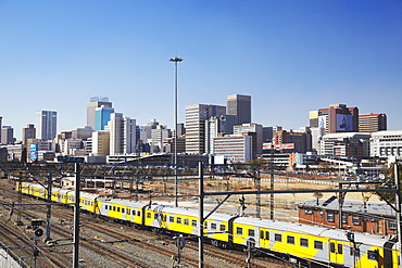 Train entering Park Station with city skyline in background, Johannesburg, Gauteng, South Africa, Africa