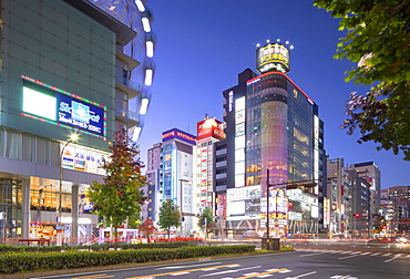 Ferris wheel and shopping street at dusk, Nagoya, Honshu, Japan, Asia