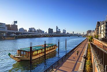 People walking along Sumida River, Tokyo, Honshu, Japan, Asia