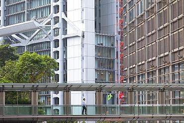 Man crossing footbridge, Admiralty, Hong Kong, China, Asia