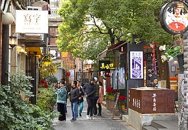 People walking around alleyways of Tianzifang, Shanghai, China, Asia
