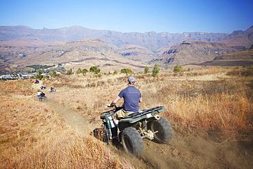 People quad biking in Cathedral Peak Nature Reserve, Ukhahlamba-Drakensberg Park, UNESCO World Heritage Site, KwaZulu-Natal, South Africa, Africa