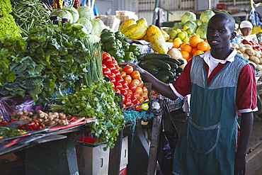 Fruit and vegetable vendor in municipal market, Maputo, Mozambique, Africa