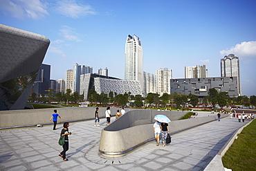 People walking in Zhujiang New Town area, Guangzhou, Guangdong, China, Asia