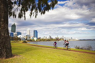 People cycling alongside Swan River, Perth, Western Australia, Australia, Pacific