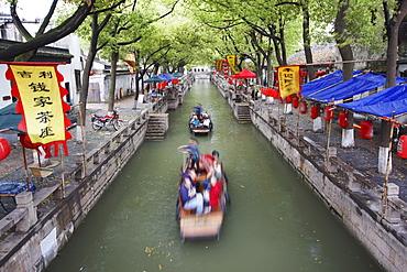 Boats taking tourists along canal, Tongli, Jiangsu, China, Asia