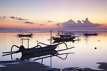 Boats on Sanur beach at dawn, Bali, Indonesia, Southeast Asia, Asia