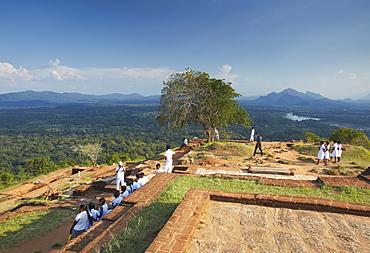 School children at summit of Sigiriya, UNESCO World Heritage Site, North Central Province, Sri Lanka, Asia