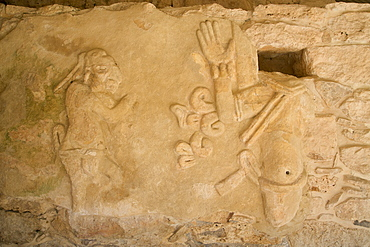 Figures of stucco relief, skeletal heads found in the niches, Castillo de Kukulcan, Mayapan, Mayan archaeological site, Yucatan, Mexico,. North America