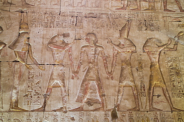 Bas-relief of Pharaoh Seti I in center with Egyptian Gods, Temple of Seti I, Abydos, Egypt, North Africa, Africa
