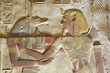 Bas-relief of the God Anubis on left, with the Pharaoh Seti I, Temple of Seti I, Abydos, Egypt, North Africa, Africa