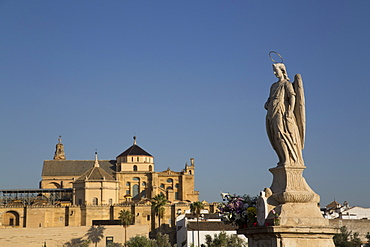 Statue of Raphael the Archangel with the Great Mosque (Mesquita) and Cathedral of Cordoba in the background, Cordoba, Andalucia, Spain, Europe