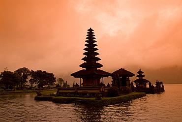 Misty sunrise at Pura Ulun Danu Bratan (Buddhist Temple), Danau Bratan, Bali, Indonesia, Southeast Asia, Asia
