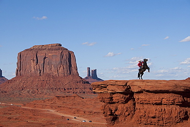 Monument Valley Navajo Tribal Park, view from John Ford's Point, Navajo Man on Horse, Utah, United States of America, North America