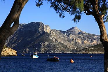 Greek fishing boat at anchor, Kalymnos, Dodecanese, Greek Islands, Greece, Europe