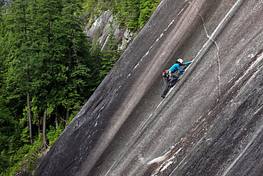 A climber scales cliffs at Squamish Chief, Squamish, British Columbia, Canada, North America