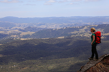 A woman looking across the plains near Three Peaks, Katoomba, Blue Mountains, New South Wales, Australia, Pacific