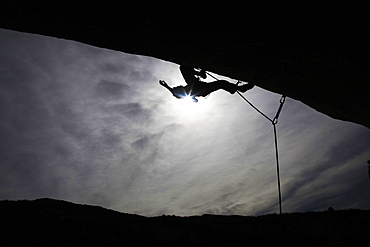 A climber scales cliffs at Buoux, Provence, France, Europe