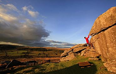 A climber bouldering on Dartmoor, Devon, England, United Kingdom, Europe