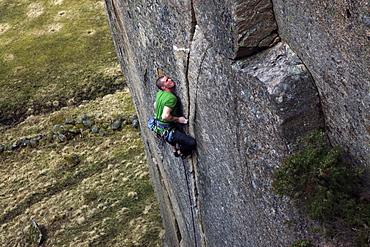 A climber scales cliffs in Bohuslan, western Sweden, Scandinavia, Europe
