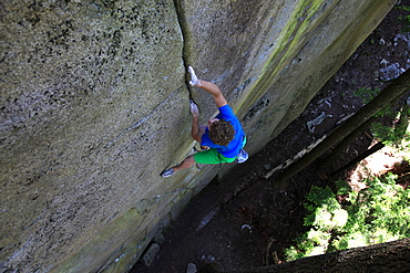 A climber soloing a difficult crack climb, Squamish Chief, Squamish, British Columbia, Canada, North America