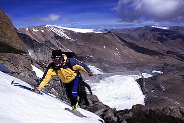 A climber ascending Mentok I, 6200m, high above Tso Mori lake, Ladakh, Himalayas, India, Asia