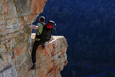A climber scaling a Via Ferrata at Siurana, Catalonia, Spain, Europe