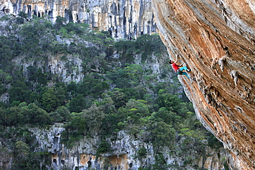 A climber scales cliffs at Kyparissi, southern Greece, Europe