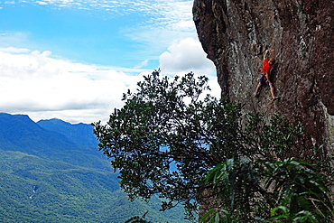 A rock climber scales the famous granite cliffs of Marumbi, a mountain in Parana State, south Brazil, South America