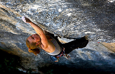 A rock climber in action on cliffs at Rodellar, Huesca Province, Aragon, Spain, Europe