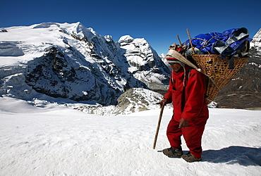 Porter carrying a load on Mera Peak, Solukhumbu, Nepal, Asia